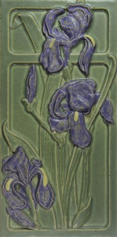 Iris in the window, purple flowers on green background art tile. Purple flowers on green background. Contemporary arts & crafts decorative tile. Handmade tile by