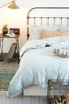 4040 Locust Frayed Edge Duvet Cover - Urban Outfitters - simple, bright bedspread. You can top with bright decorative pillows to give a spring feel.