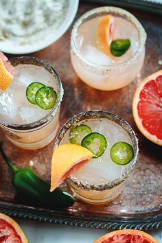 1 1/2 cups, tequila, 2 cups, grapefruit juice, 3/4 cups fresh lime juice, 4 tablespoons honey, 1-2 whole jalapeños, sliced