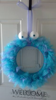 Sully Monsters Inc wreath made by Chasing Cotton.  Perfect for a not so scary halloween decor!