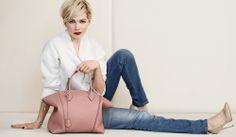 Michelle Williams with the Louis Vuitton Lockit Handbag.  /quiero una porfavor/