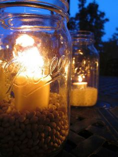 DIY::Outdoor Mason Jar Lighting for Pennies ! Make this SIMPLE outdoor lighting for pennies! Just fill mason jars with dried beans & rice, then add a candle. Perfect for both day & night entertaining!