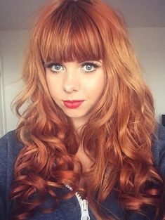 light red wavy hairstyle with bangs