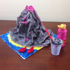 Making a volcano... paper, cardboard, plastic bottle, paint, glue and imagination