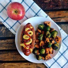 veggie dog, roasted vegetables, fruit