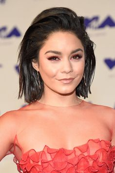 Vanessa Hudgens. Yes, that is red, glitter-flecked eyeliner, and yes, it's paired with a slicked-back, wet-look bob. See more of the best VMA beauty looks here!