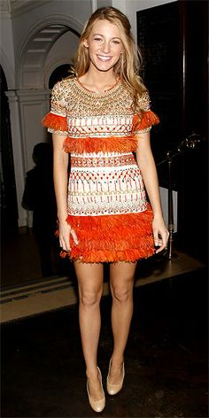 Blake Lively  Lively arrived at a Van Cleef & Arpels dinner in an fringed and beaded Marchesa dress and nude heels.