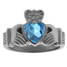 Blue Topaz Irish Claddagh Men's Wedding Ring In Black Rhodium Plated White Gold Gemologica.com offers a large selection of #Irish #Claddagh #Symbol #Rings in #Silver #10K #14K #18K #yellow #rose #white #black gold with #birthstones #gemstones #wedding #engagement rings for #men #women. Let love and friendship reign with Women's and men's claddagh rings at #Gemologica #jewellery #customer #reviews