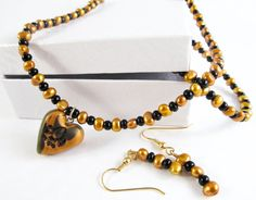 Saints+Black+and+Gold+Necklace+set+by+MissEsAccessories+on+Etsy,+$18.00
