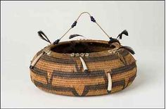 """Weaving a Collection: Native American Baskets from the Bruce Museum Pomo Gift Basket, California, 19th century, 5 _ h x 14 d x 19 c inches, One rod coiling; horizontal """"V"""" motifs and blue seed beads. Bruce Museum collection 19908"""