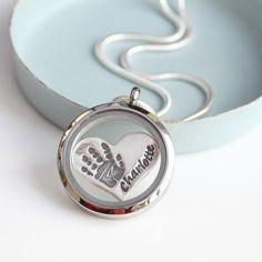 Floating locket with heart shaped handprint charm
