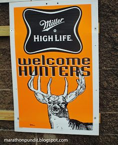 "Miller High Life ""Welcome Hunters"" sign outside of a bar in Lacon, Illinois"