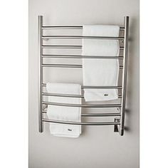 The Radiant collection features affordable, wall-mounted towel warmers. Choose between a round or square bar design, straight or curved horizontal bars, and hardwired or plug-in. A shelf unit is also available for to warm/dry towels and provide additional storeage. Made of high quality 304 stainless steel, they are offered in brushed and polished stainless steel finishes. Using Dry Element Technology, it takes only 15 to 20 minutes for the units to heat up. The integrated on/off switch with… Heated Towel Bar, Warm Bathroom, Bathroom Ideas, Towel Warmer, Bath Or Shower, Wet Rooms, Brushed Stainless Steel, Ski Jackets, Electric