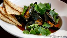 mussels | p.e.i. mussels · garlic · white wine · cilantro ·  masa bread · red curry rocoto sauce