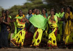 https://flic.kr/p/6H2hbg | Gabbra women dancing - Kenya | The Gabbra (or Gabra) in the Chalbi desert of northern Kenya, where they share portions of the territory with the Borana. They have indeed adopted the Oromo language of the Borana. Through religious and cultural ties, marriages and alliances, the Gabbra have become part of the Borana peoples. But they also retain older Somali-Rendille identities.The Gabbra are attached to camels but have also cattle. Animals belong to the whole tribe…