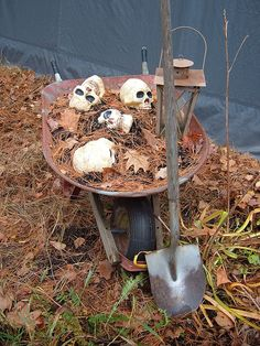 This idea would make the neighbors wonder. I would start a hole in the yard next to wheelbarrow and pile additional dirt plus maybe even put a low wattage light down in the hole to cast additional spookiness to this..!!