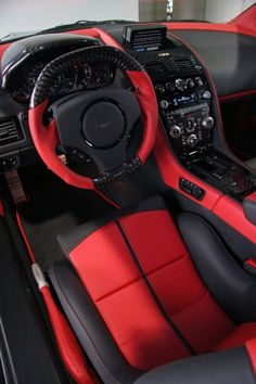 Mansory is always pretty creative with its interior upgrades and their work on the Aston Martin DB9 and DBS is no exception. I love the red and black theme. Carbon fiber pieces and aluminum pedals complete the racy cool look for the interior of the car.