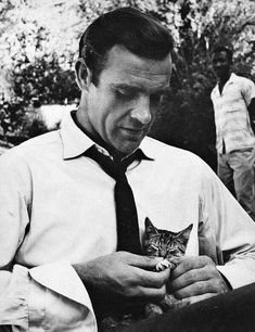 Sean Connery with a cat on the set of Dr. NO