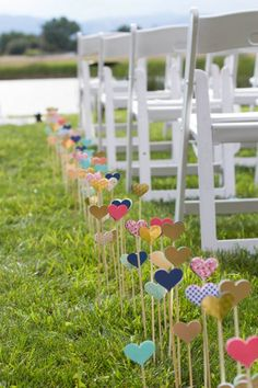 Hearts on sticks as wedding aisle decor - click through to learn how to make them!