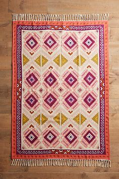 inspiration post- this would be a great design idea to paint onto a plain canvas rug. Love the colours and design.