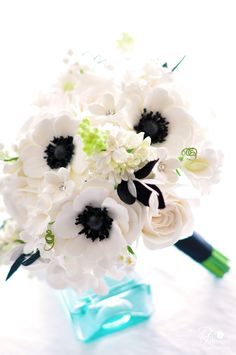 DK Designs - just created this beautiful white, black and silver bouquet - anemones, gardenias, lilac, lily of the valley, sweet peas and roses.