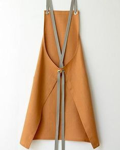 This coppery orange linen is soft and muted yet distinctively modern. We've chosen the soft and absorbent tea towel in Stone linen for its kitchen companion. Pinafore Apron, Viking Dress, Viking Woman, Viking Art, Japanese Sewing, Retro Apron, Linen Apron, Sewing Aprons, Apron Designs