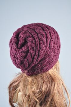 """Very fashionable! Burgundy Chunky Wool Hat! This wool hat features on an interesting twisted pattern. It suits any outfit style. Length:11"""" from top to bottom Circumference: 18"""" (relaxed) 24"""" (stretched) – fit any size head! Hand wash in cold water with detergent or shampoo and"""