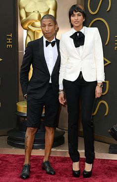Pharrell Williams (with wife Helen Lasichanh) arrives at the Oscars wearing shorts!