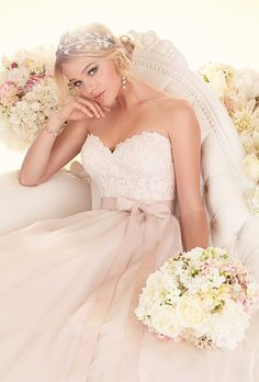 Brides: Essense of Australia. More Details From Essense of Australia��This soft organza and tulle wedding dress features a fitted bodice with elegant lace details, a whimsical waist sash, and a flowing, full skirt.