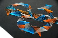 Paper embroidery - love the colors and the contrast with the black paper