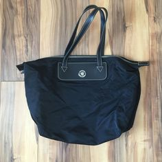 """Dooney & Bourke Black Nylon Bag Dooney & Bourke Black Nylon Packable tote bag. All weather black leather handles. One open pocket on inside. No wear on handles, corners, bottom, just some wrinkling since bag is pliable! Measures 15""""W X 12""""H and strap drop of 8"""". Excellent condition! Dooney & Bourke Bags"""