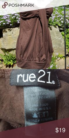 Rue 21 Top Brown Gathered at cleavage  Elastic in back for comfort     ♥️From a smoke & pet free home♥️ 🌹Consider bundling 1 or more items🌹  This will allow me to provide you with a deeply discounted offer! No Commitments. You can accept/counter offer/decline. The more you bundle, the more you save. Sometimes up to 75%! Note: Offers are only valid for 24 hrs Rue21 Tops