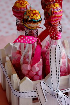 Easy party favour! Fill glass bottles with candy and top with a lollipop. Decorate with pretty ribbon for an added touch. (Photo: Alida Ryder - Simply Delicious)