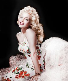 Lana Turner 40s movie star pin up girl portrait color photo print ad blonde hair sundress white red floral spaghetti straps short knee length casual day wear sexy glam