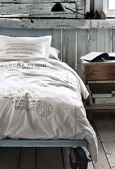 bed linens~old flour sacks made in to bedspread....love the bed frame too!