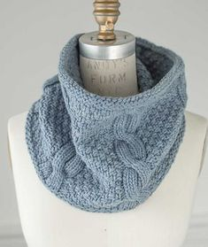 This free pattern creates a chunky, cozy cowl that takes advantage of doubled yarn for a nice, quick knit! Plump cables twist up among fields of delightfully dense moss stitch for a perfectly sized cowl with just the right amount of structure.