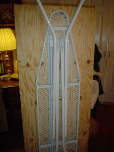 A Serious Ironing Board -- unpadded it would make a collapsible cutting table...