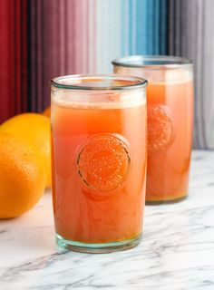 Watermelon orange ginger turmeric juice is a fruity, refreshing juice spiced up with superfoods - fresh ginger and turmeric. This juice is smooth with no juicer required!