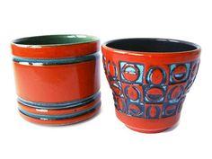 Hoi! Ik heb een geweldige listing gevonden op Etsy https://www.etsy.com/nl/listing/221583513/vintage-red-ceramic-planter-west-german