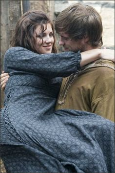 Robin Hood holding Maid Marian from the BBC show