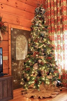 7 Ways to Make Your Fake Tree Look Full And Fabulous on The Cheap Fill in empty spaces around your tree with large bows made from gift wrapping ribbons.
