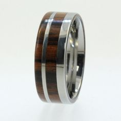 Titanium Wooden Wedding Ring with Ironwood Wood and Titanium pinstripe inlay. $265.00, via Etsy.