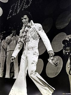 Elvis carrying the crown given to him by a female fan at the end of the Aloha performance.