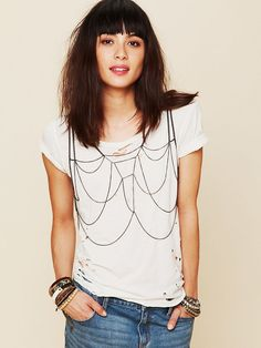 Metal Chain Bra    Extravagantly tiered metal chain bra. Pull it over your head and arms. Fits perfectly like a tank. Delicate and subtle, with a cool rock and roll edge. Wear it over your vintage rock tees or a basic tank, or toughen up a pretty dress with it