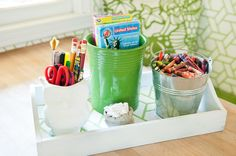 Having a few little trays or buckets ready to grab with easy activities can be a lifesaver when you need to get the kids busy in a hurry. Try a tray with cookie cutters and a jar of homemade play dough, an art tray or a dishpan filled with water toys or baby dolls for washing.
