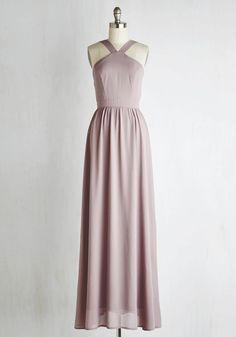 Lead elegance by example, choosing to this dusty lavender maxi dress to help guide alongside you. Charmed with a tapered neckline, princess seams, a golden back zipper, and a gathered empire waistline, this sweeping frock is an expression of your glam grandeur!