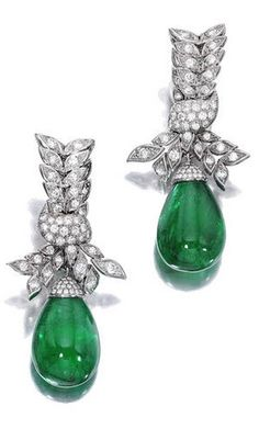 A pair of emerald and diamond pendant earrings each designed as a circular-cut diamond ribbons, suspending emerald drops, weighing 50.66 carats total, from pavé-set diamond caps; surmounts signed Boucheron; estimated total diamond weight: 6.45 carats; mounted in platinum.