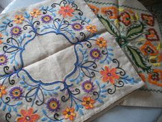 folk art style embroidery in wool on linen