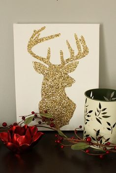 A simple silhouette traced on a canvas, painted in with mod podge, and dusted with glitter!