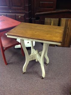Hall table with nice finished oak top and glazed white bottom.
